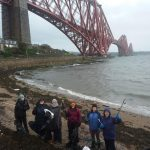 standing on North Queensferry Beach with the Forth Rail Bridge in background