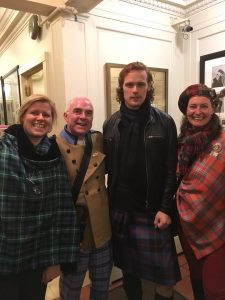 3 scottish tourist guides in New York hotel corridor with Sam Heughan