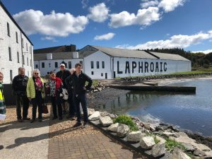 Whitewashed Laphroaig Distillery on seasfront