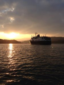 Hebridean Princess cruise ship looking in to sunset