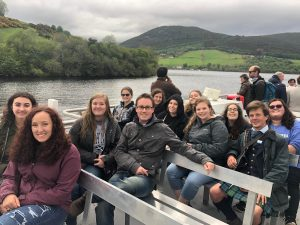 guide with a school group on cruise boat in Scotland